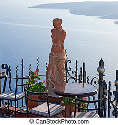 Santorini Greece, Statue of Aphrodite in outdoor cafe
