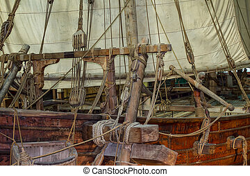 Old sailing ship with sails and ropes