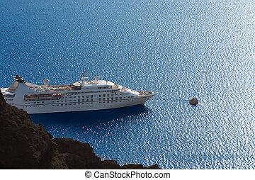 luxury white cruise ship on a clear day with calm seas and...