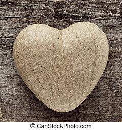 heart - a papier-mache heart on an old wooden surface