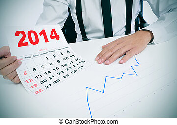 man in suit with a chart and a 2014 calendar - businessman...