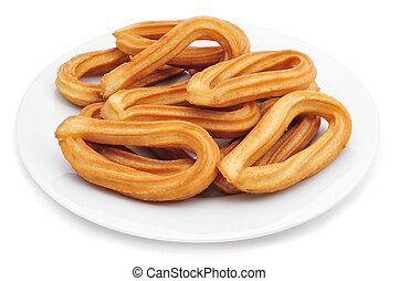 churros typical of Spain - a plate with churros typical of...