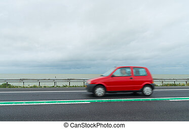 red car passing on a road on a dike between lelystad and...