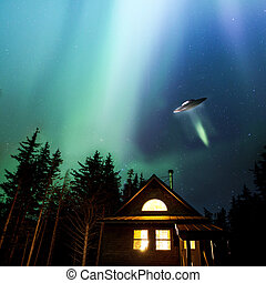 Alaskan UFO - UFO flying over an Alaskan cabin with colorful...