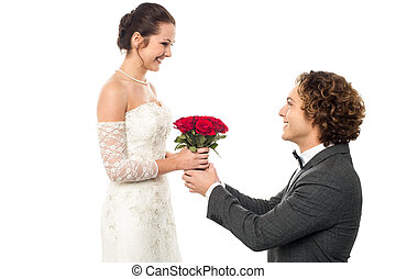 Accept my token of love - Romantic proposal by a groom