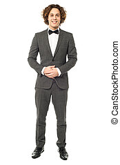 Hansome groom posing with clasped hands - Stylish wedding...