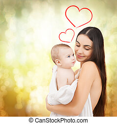 happy mother feeding her adorable baby - family, children,...