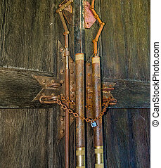 Wooden door with rusty Chain and old Padlock