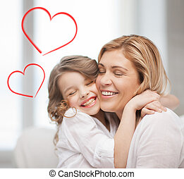 smiling mother and daughter hugging - family, children and...