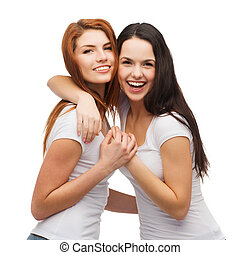 two laughing girls in white t-shirts hugging - friendship...