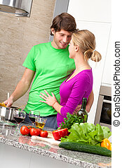 Preparing romantic dinner together in kitchen, vertical