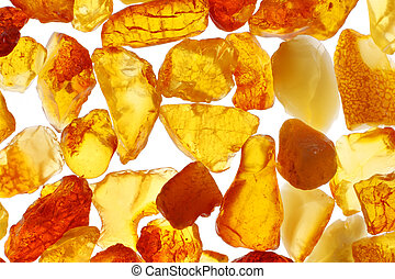 Amber - Macro shot of baltic amber stones. Backlight...