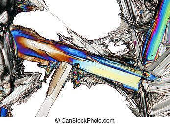 Microscopic view of colorful potassium nitrate crystal...