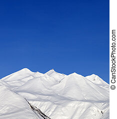 Snowy mountains and blue sky