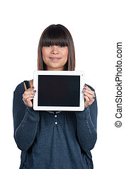 Young woman shows a tablet