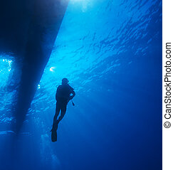 Scuba Diver with Sun Rays and Boat