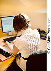 businesswoman at computer - businesswoman at desk operating...