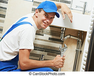 Young smiling plumber man worker - Young happy plumber...