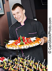 chef with food on plates