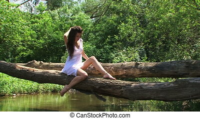 Model on a riverside - Curly model posing on a riverside...