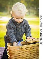 Blonde Baby Boy Opening Picnic Basket Outdoors at the Park -...