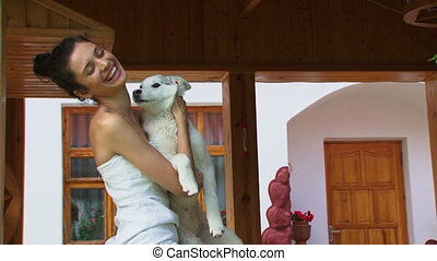 Dog and its owner - Woman holding a white dog