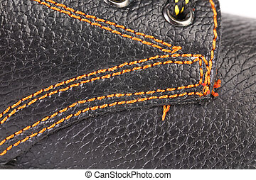 Shoe stiches on boot close up Whole background