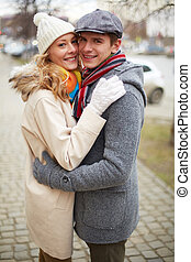 Sweethearts - Portrait of happy guy and his girlfriend in...