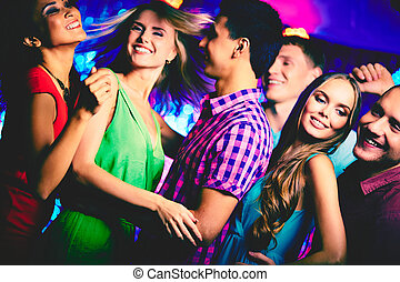 Dancing at disco - Happy young friends dancing in the...