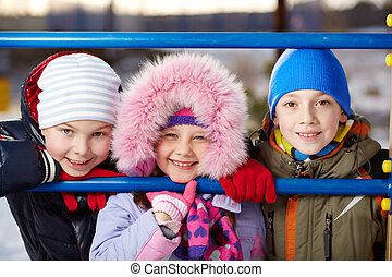 Group of kids - Happy kids in winterwear looking at camera...