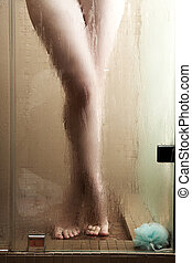 Woman in Shower - Sexy young adult Caucasian woman with long...