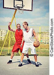 Two basketball players on the court