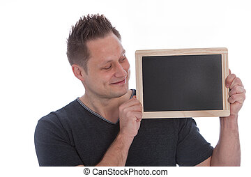 Man holding up a blank slate - Smiling attractive young man...