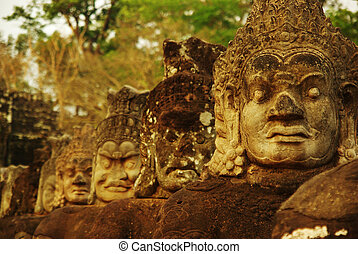 Carved stone heads at ancient temple in Angkor Wat, Cambodia...