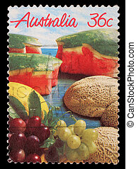 A stamp printed in Australia shows image of a spread of...