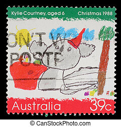 A stamp printed in the Australia shows Koala Wearing a Santa...