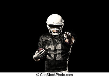 Football Player with a black uniform, on a black background