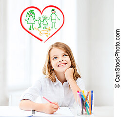smiling little student girl drawing at school - education,...