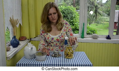 calendula tea woman - sad blonde woamn room rural prepare...