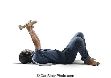 Young boy playing with toy airplane - Young boy playing with...