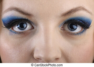 close-up portrait of beautiful girl's eye-zone make-up with blue eye shadows