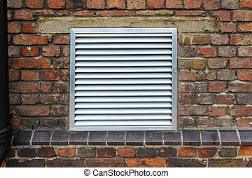House ventilation grill on brick wall facade