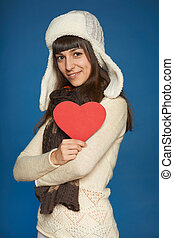 Winter woman in warm clothing giving heart shape - Winter...