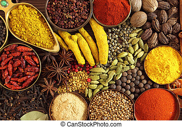 Indian spices - Spices and herbs in metal bowls. Food and...