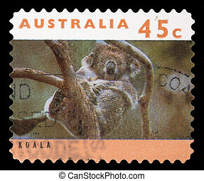 A stamp printed in Australia shows a Koala asleep in tree -...