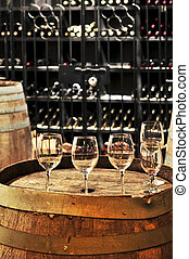 Wine glasses and barrels - Row of wine glasses on barrel in...