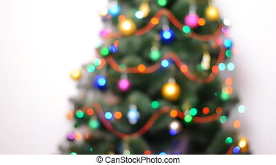Blurred Green Christmas Tree with Gifts and Bulbes Blinking