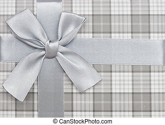 gift box with silver ribbon and bow isolated on white...