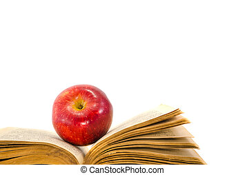 withered red apple and old books