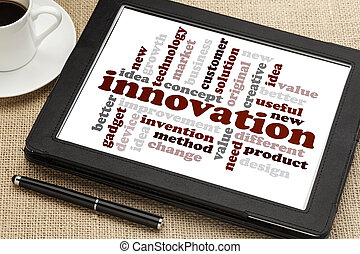 innovation word cloud on a digital tablet screen with a cup...